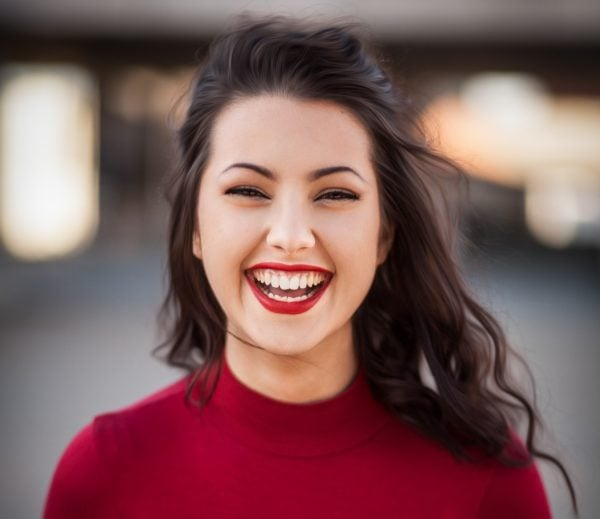 Smiling girl with red top