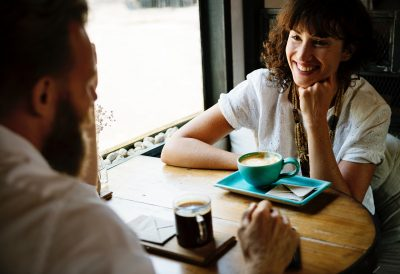 woman sitting for coffee with man