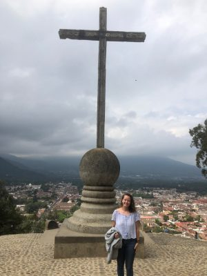 Volunteer standing in front of a cross in Quetzaltenango