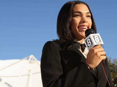 Broadcast journalist with microphone